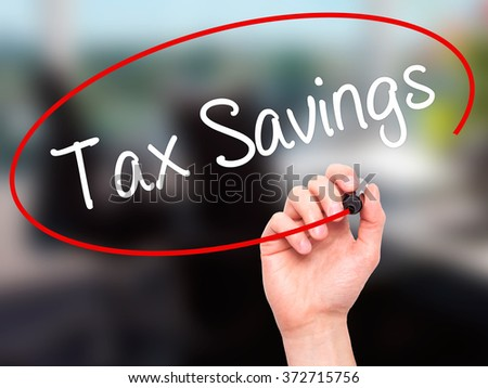 Man Hand writing Tax Savings with black marker on visual screen. Isolated on background. Business, technology, internet concept. Stock Photo - stock photo