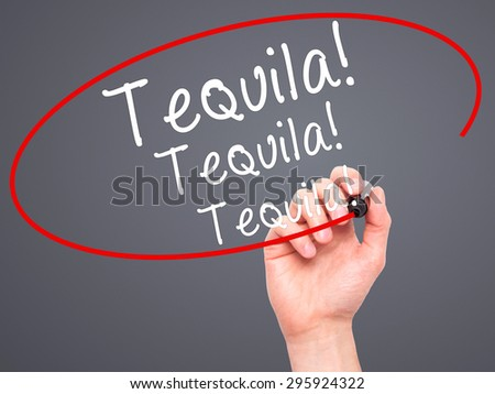 Man Hand writing Tequila with black marker on visual screen. Isolated on grey. Business, technology, internet concept. Stock Photo - stock photo