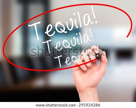 Man Hand writing Tequila with black marker on visual screen. Isolated on office. Business, technology, internet concept. Stock Photo - stock photo