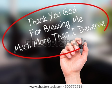 Man Hand writing Thank You God For Blessing Me Much More Than I Deserve with black marker on visual screen. Isolated on office. Business, technology, internet concept. Stock Photo - stock photo
