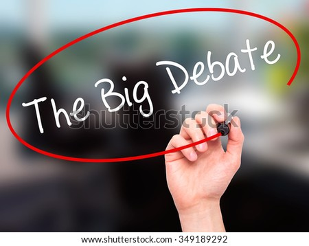 Man Hand writing The Big Debate with black marker on visual screen. Isolated on background. Business, technology, internet concept. Stock Photo - stock photo