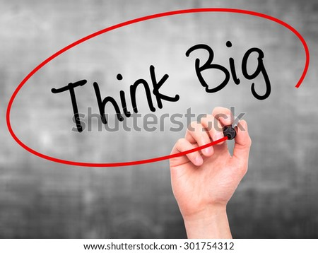 Man Hand writing Think Big with black marker on visual screen. Isolated on grey. Business, technology, internet concept. Stock Photo - stock photo