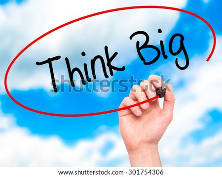 Man Hand writing Think Big with black marker on visual screen. Isolated on sky. Business, technology, internet concept. Stock Photo - stock photo