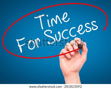 Man Hand writing Time For Success with marker on transparent wipe board. Isolated on blue. Business, internet, technology concept. Stock Photo - stock photo