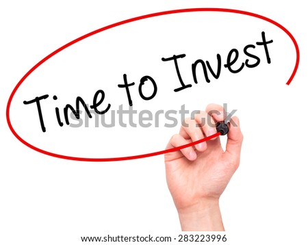 Man Hand writing Time to Invest with marker on transparent wipe board. Isolated on white. Business, internet, technology concept. Stock Photo - stock photo