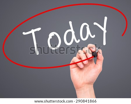 Man Hand writing Today with black marker on visual screen. Isolated on grey. Business, technology, internet concept. Stock Image - stock photo