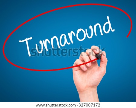 Man Hand writing Turnaround with black marker on visual screen. Isolated on blue. Business, technology, internet concept. Stock Photo - stock photo