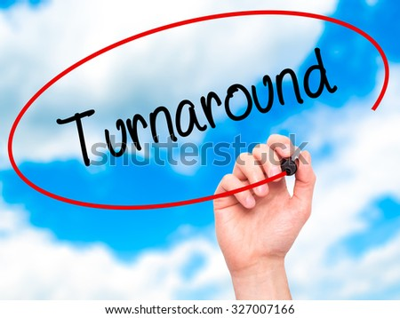 Man Hand writing Turnaround with black marker on visual screen. Isolated on sky. Business, technology, internet concept. Stock Photo - stock photo