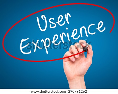 Man Hand writing User Experience with black marker on visual screen. Isolated on blue. Business, technology, internet concept. Stock Image - stock photo