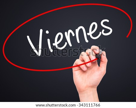Man Hand writing Viernes (Friday in Spanish) with black marker on visual screen. Isolated on black. Business, technology, internet concept. Stock Photo - stock photo