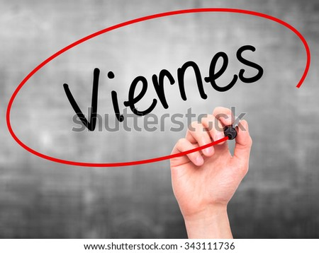 Man Hand writing Viernes (Friday in Spanish) with black marker on visual screen. Isolated on grey. Business, technology, internet concept. Stock Photo - stock photo