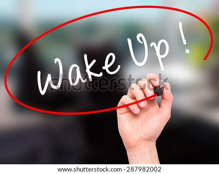 Man Hand writing Wake Up with black marker on visual screen. Isolated on office. Business, technology, internet concept. Stock Image - stock photo