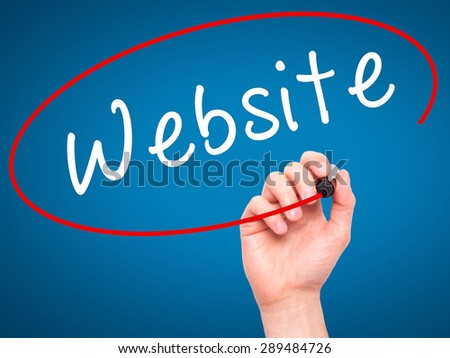 Man Hand writing Website with black marker on visual screen. Isolated on blue. Business, technology, internet concept. Stock Image - stock photo