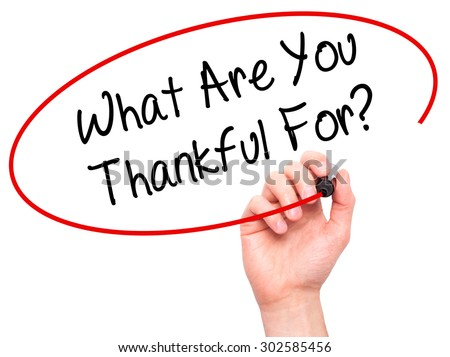 Man Hand writing What Are You Thankful For? with black marker on visual screen. Isolated on white. Business, technology, internet concept.  - stock photo