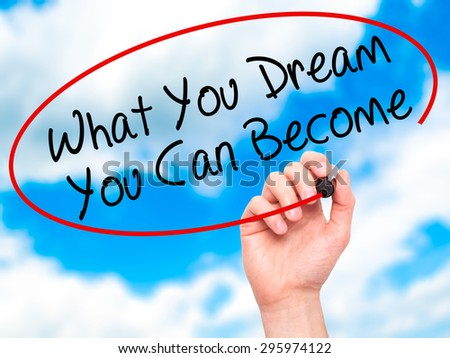 Man Hand writing What You Dream You Can Become with black marker on visual screen. Isolated on sky. Business, technology, internet concept. Stock Photo - stock photo