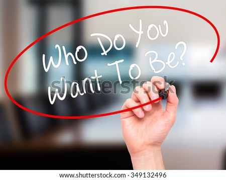 Man Hand writing Who Do You Want To Be? with black marker on visual screen. Isolated on background. Business, technology, internet concept. Stock Photo