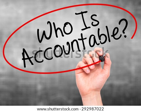 Man Hand writing Who Is Accountable? with black marker on visual screen. Isolated on grey. Business, technology, internet concept. Stock Image - stock photo