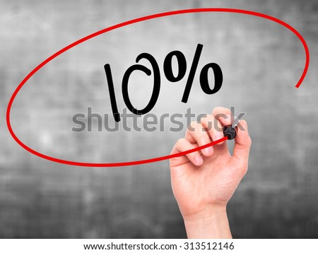 Man Hand writing 10%  with black marker on visual screen. Isolated on grey. Business, technology, internet concept. Stock Photo