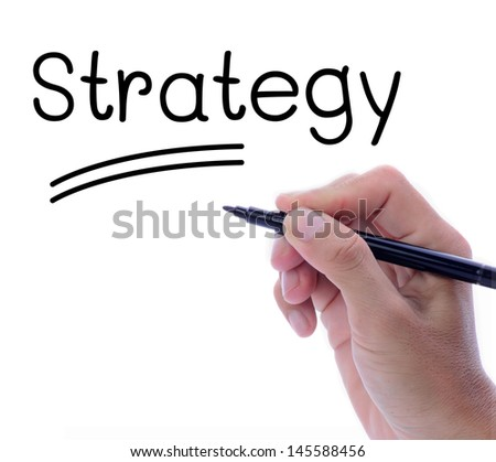 Man hand writing word, strategy, in motivation concept - stock photo