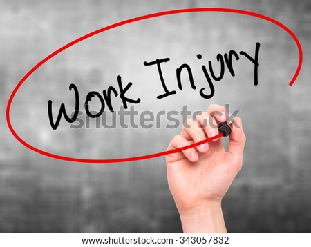 Man Hand writing Work Injury with black marker on visual screen. Isolated on grey. Business, technology, internet concept. Stock Photo - stock photo