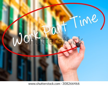 Man Hand writing Work Part Time with black marker on visual screen. Isolated on city. Business, technology, internet concept. Stock Photo  - stock photo