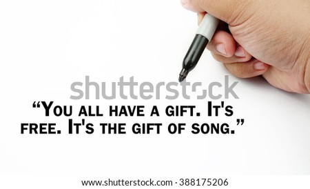 "Man Hand writing ""you all have a gift. its free. its the gift of song"" with black marker on visual screen. Isolated white background. Business, technology, internet concept. Stock Photo"