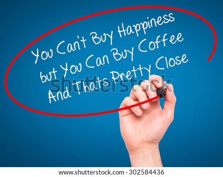 Man Hand writing You Cant Buy Happiness but You Can Buy Coffee And Thats Pretty Close with black marker on visual screen. Isolated on blue. Business, technology, internet concept.