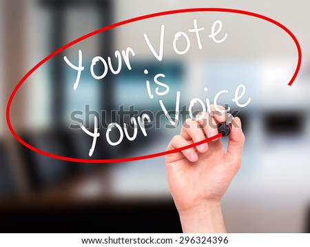 Man Hand writing Your Vote is Your Voice with black marker on visual screen. Isolated on office. Business, technology, internet concept. Stock Photo - stock photo