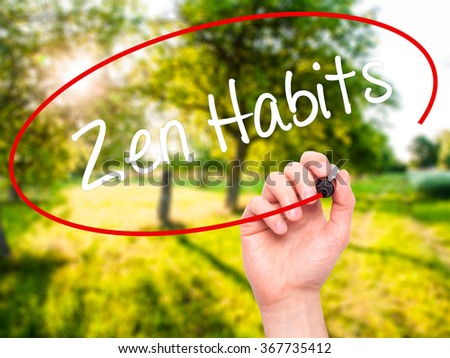 Man Hand writing Zen Habits with black marker on visual screen. Isolated on background. Business,  technology, internet concept. Stock Photo - stock photo