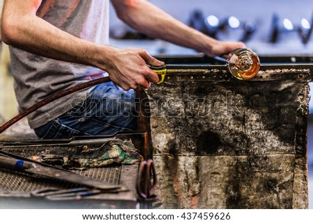 Man Hands Closeup Cooling a Blown Glass Piece with a Air Blower - stock photo
