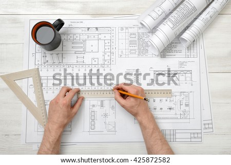 Man hands draw design with pen and wooden rulers. Working process. Technical drawing. Workplace of architect or constructor. Engineering work. Construction and architecture. - stock photo