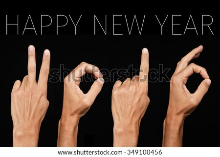 man hands forming the number 2016, as the new year, and the text happy new year on a black background
