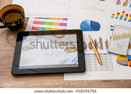 man hands hold tablet with business graph on desk - stock photo
