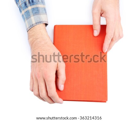 Man hands holding book, isolated on white