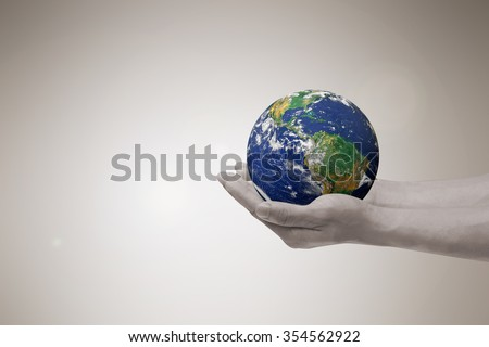 man hands holding circle world over soft sepia color background:human hand protect/prevent the earth from pollution concept:carbon credit:safe/save planet concept:image in tan brown color warm tone - stock photo