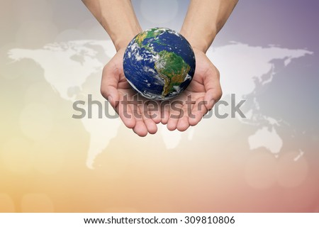 man hands holding the earth on blurred map.protection planet mother earth concept:reduce carbon dioxide emission:pure air:Elements of this image furnished by NASA.safe and healing world concept.  - stock photo