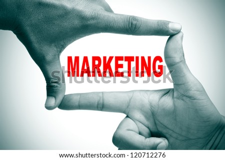 man hands making a frame with its fingers and the word marketing written inside - stock photo