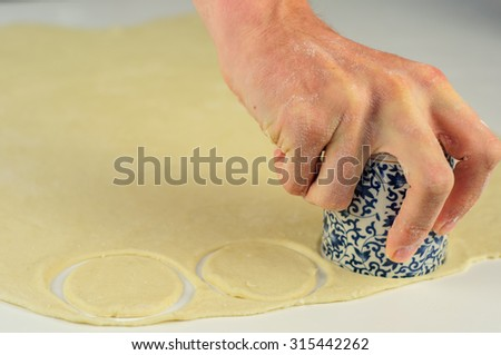 Man hands making homemade dumplings with meat