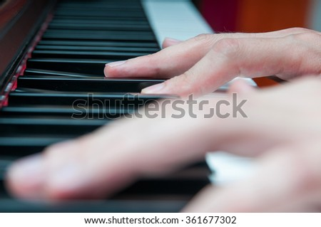 Man hands on a piano keyboard - stock photo
