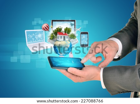 Man hands using smart phone. Electronics near Earth. Laptop, internet tablet and phone. Element of this image furnished by NASA - stock photo