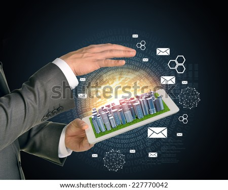 Man hands using tablet pc. Business city on touch screen. Business concept
