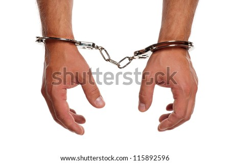 Man hands with handcuffs isolated on white background - stock photo