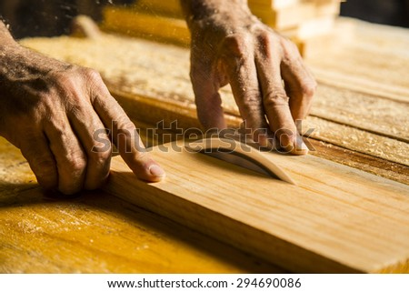 Man hands working in furniture wood industry - stock photo
