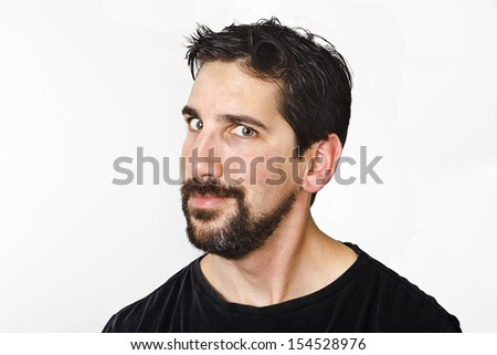 Man has a grin as if he was reacting to something he saw or just came up with a bad idea.  - stock photo