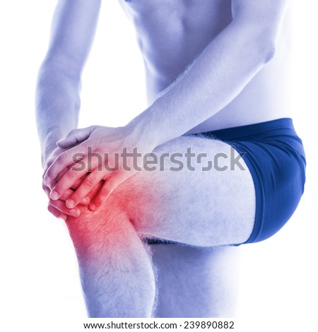 Man has knee pain and contussion - studio shoot - stock photo