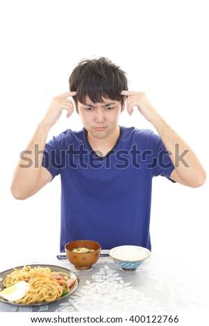 Man has no appetite - stock photo