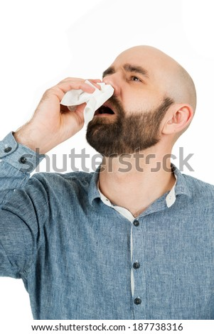 man has nosebleed, isolated on white - stock photo