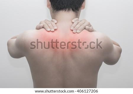 Man has shoulder pain - stock photo