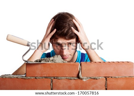 Man having a problem with building a wall