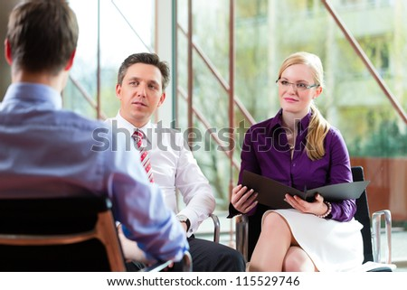 Man having an interview with manager and partner employment job candidate hiring resume CEO work - stock photo